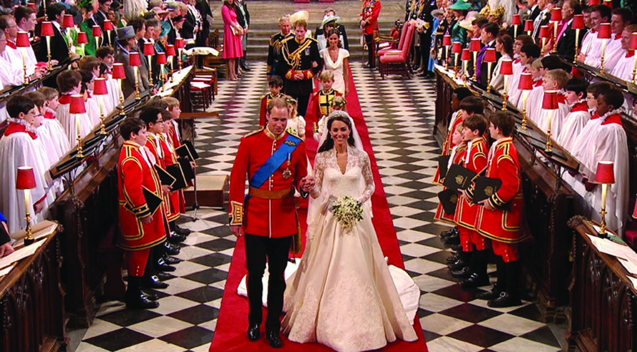 In this image taken from video, Britain's Prince William, left, and his wife, Kate, the Duchess  of Cambridge, walk down the aisle together at Westminster Abbey for the Royal Wedding in London on Friday, April, 29, 2011. (AP Photo/APTN) EDITORIAL USE ONLY NO ARCHIVE PHOTO TO BE USED SOLELY TO ILLUSTRATE NEWS REPORTING OR COMMENTARY ON THE FACTS OR EVENTS DEPICTED IN THIS IMAGE
