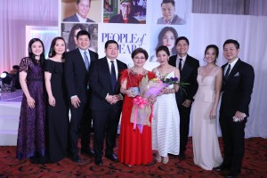 Rosalind Wee is flanked by children and in-laws, Audrey, Elaine, John, Norman, Dimples, Cesar Jr., Faith and Francis