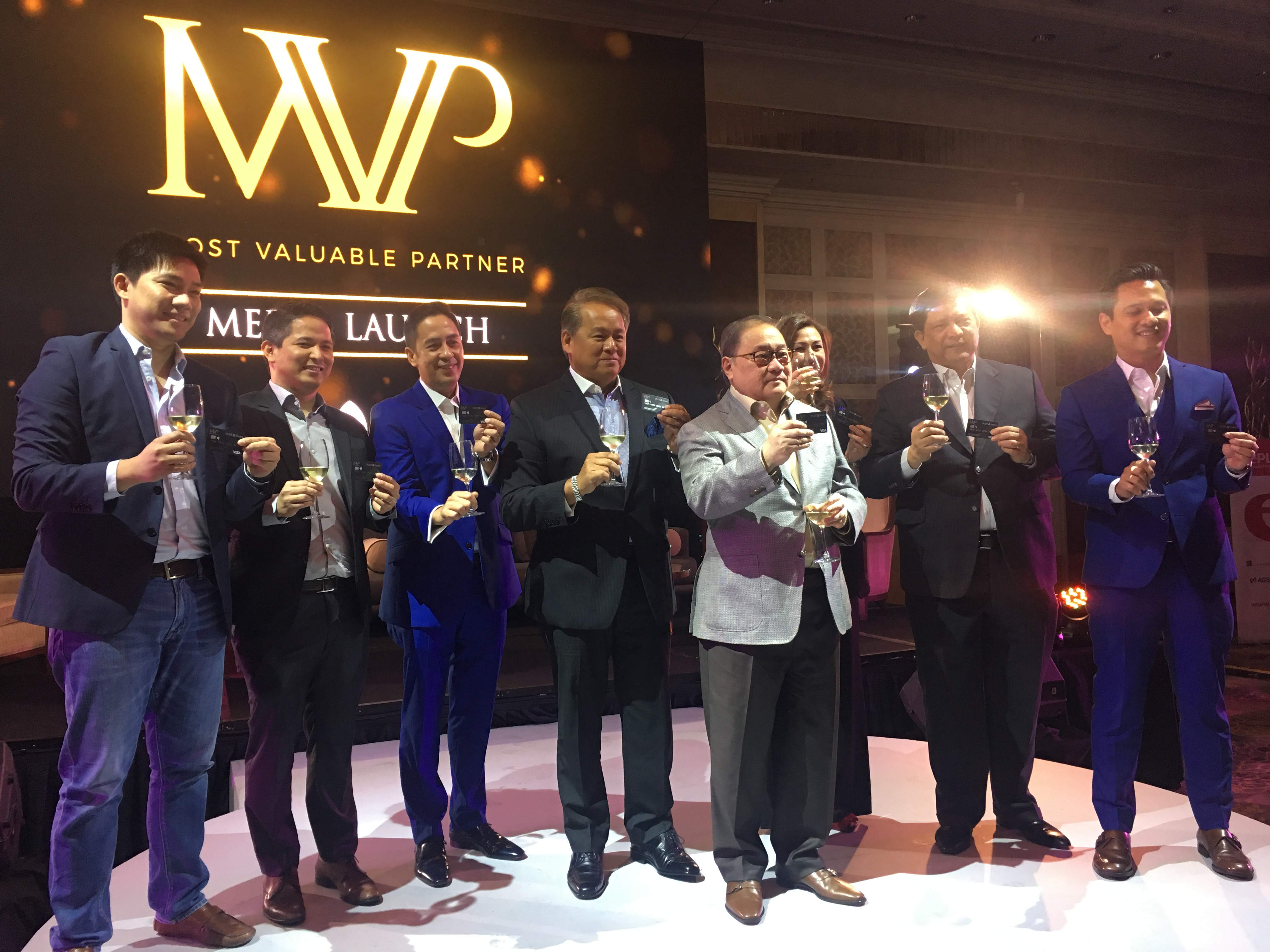 Manny V. Pangilinan, chair and CEO of PLDT and Smart, and the rest of his team during the MVP Rewards Card's launch at Makati Shangri-La